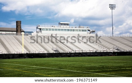 Generic football stadium with blue sky - stock photo