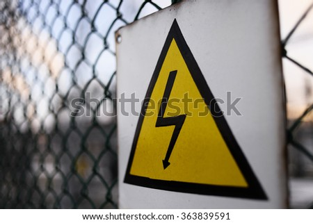 Generic High Voltage Danger Sign, Danger symbol. Black arrow isolated in yellow triangle. Warning icon.  - stock photo