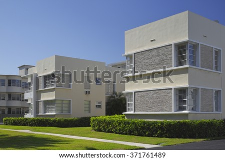Generic lowrise apartment building with garden - stock photo