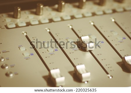 generic mixer close up. one shift is up while all the others are at minimum - stock photo
