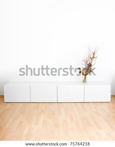 Generic modern room with shelves and wooden floor - stock photo