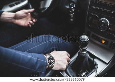 Generic photo of man driving a car