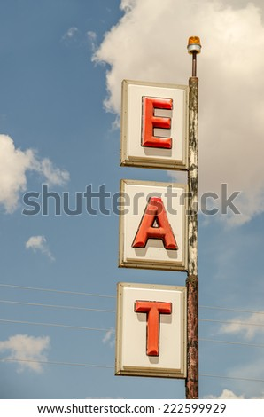 Generic sign along Route 66 telling of an eating establishment.  It could be a restaurant, cafe, or diner. - stock photo