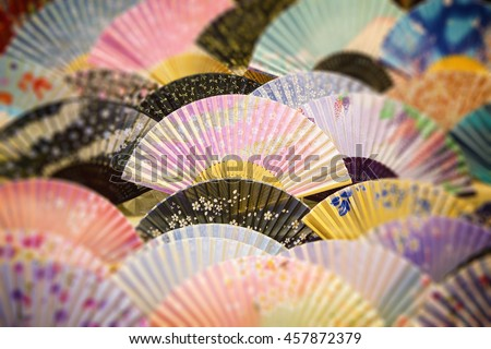 Generic souvenir fans with traditional decoration, Japan.  - stock photo
