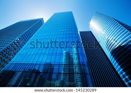 Generic unidentified business skyscrapers, sunny blue sky. - stock photo