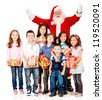 Generous Santa Claus with a group of children holding presents - isolated - stock photo