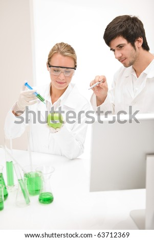Genetic engineering - scientists in laboratory, GMO testing experiment - stock photo