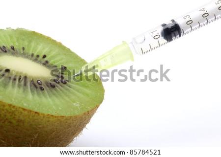 Genetic food engineering concept with Kiwi & syringe - stock photo