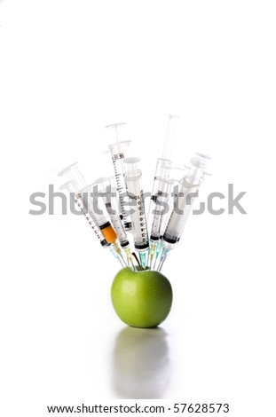 Genetic modification of fresh green apple - stock photo