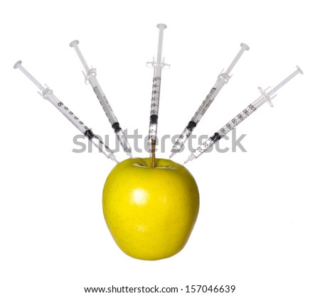 Genetically modified apple and syringes isolated on white background. GMO food concept. Genetic injection - stock photo