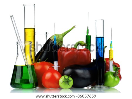 Genetically modified organism - vegetables with syringes and laboratory glassware on white background - stock photo