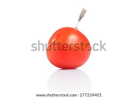 Genetically modified tomato - GMO - stock photo