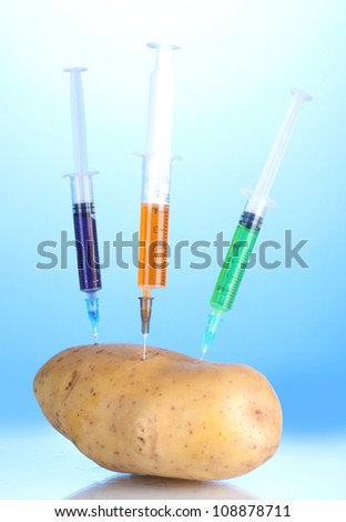 Genetically modified vegetable on blue background - stock photo