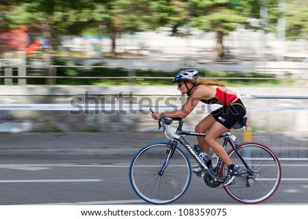 GENEVA - JULY 22: Athlete competing in the cycling section of the 2012 ITU Triathlon European Cup, July 22, 2012 in Geneva, Switzerland