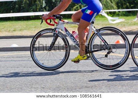 GENEVA - JULY 22: Athlete competing in the cycling section of the 2012 ITU Triathlon European Cup, July 22, 2012 in Geneva, Switzerland - stock photo