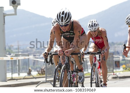 GENEVA - JULY 22: Athletes competing in the cycling section of the 2012 ITU Triathlon European Cup, July 22, 2012 in Geneva, Switzerland - stock photo