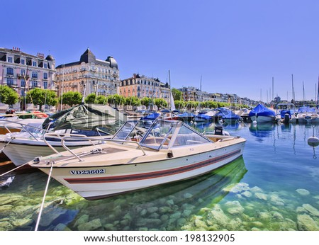 GENEVA-JULY 25, 2011. Luxurious yachts anchored at Lake Geneva. The cost of living in Switzerland is among the highest in the world, with Zurich and Geneva ranked second and third most expensive. - stock photo
