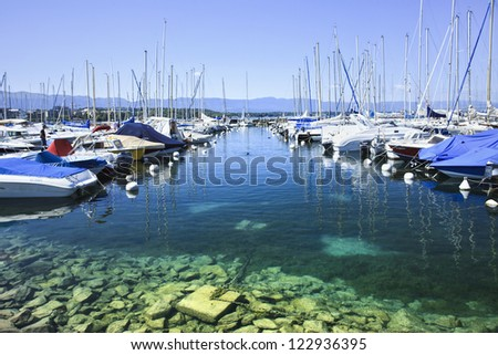 GENEVA-JULY 25. Moored yachts in Lake Geneva: A recent Mercer survey found Geneva to have the third-highest quality of life of any city in the world (behind Vienna, Zurich). Geneva, July 25, 2011. - stock photo