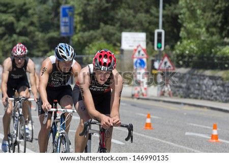 GENEVA - JULY 21: Unidentified athletes compete in the mens cycling race of the 2013 ITU Triathlon Continental European Cups, July 21, 2013 in Geneva, Switzerland.  - stock photo