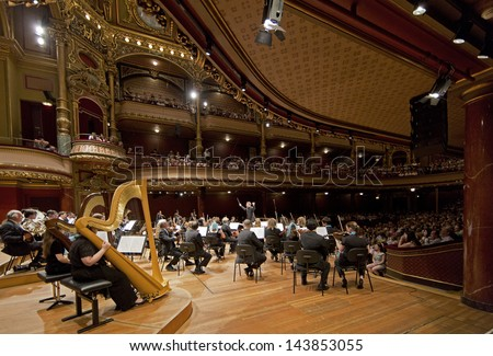 GENEVA - JUNE 23: Antoine Marguier conducts the United Nations Orchestra as part of the Fete de la Musique at the Victoria Hall June 23, 2013 in Geneva, Switzerland. - stock photo
