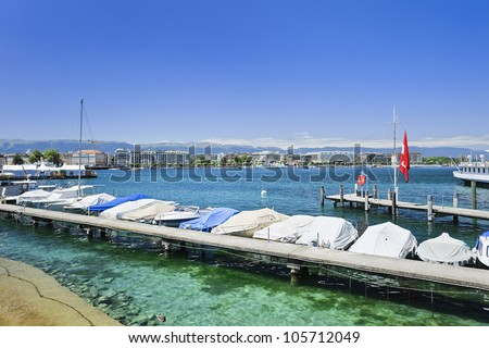 GENEVA�JUNE 25. Luxurious boats and yachts anchored on June 25, 2011 in Lake Geneva. A 2009 survey by Mercer found Geneva having the third-highest quality of life of any city around the world. - stock photo