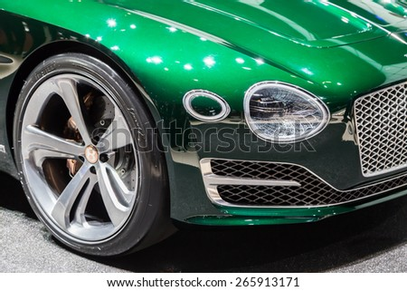 GENEVA, MAR 3: Bentley Exp 10 Speed 6 Concept car wheel and headlight details, presented at the 85th International Motor Show in Geneva, Switzerland on March 3, 2015. - stock photo