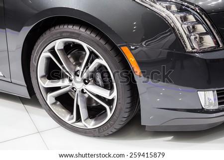 GENEVA, MAR 3: 2016 Cadillac ELR car wheel details, presented at the 85th International Motor Show in Geneva, Switzerland on March 3, 2015. - stock photo