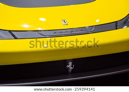 GENEVA, MAR 3: Ferrari car logo, presented at the 85th International Motor Show in Geneva, Switzerland on March 3, 2015. - stock photo