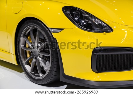 GENEVA, MAR 3: Porsche Cayman GT4 car wheel and headlight details, presented at the 85th International Motor Show in Geneva, Switzerland on March 3, 2015. - stock photo