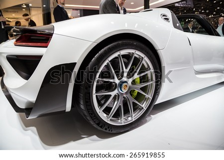 GENEVA, MAR 3: Porsche 918 Spyder car wheel and light details, presented at the 85th International Motor Show in Geneva, Switzerland on March 3, 2015. - stock photo