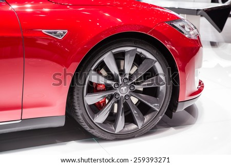GENEVA, MAR 3: Tesla Model S P85D wheel and headlight detail, presented at the 85th International Motor Show in Geneva, Switzerland on March 3, 2015. - stock photo