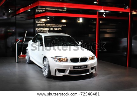 GENEVA - MARCH 3 : A  BMW 1er M coupe car show on display at 81th International Motor Show Palexpo-Geneva on March 3, 2010 in Geneva, Switzerland. - stock photo
