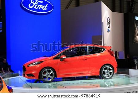 GENEVA, MARCH 8 : A Ford Fiesta st car on display at 82th International Motor Show Palexpo-Geneva on March 8, 2012 in Geneva, Switzerland. - stock photo