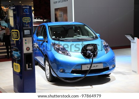 GENEVA, MARCH 8 : A Nissan  leaf electric vehicle  car on display at 82th International Motor Show Palexpo-Geneva on March 8, 2012 in Geneva, Switzerland. - stock photo