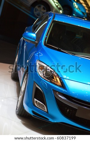 GENEVA - MARCH 7:Blue Mazda 3 on display at the 79th International Motor Show Palexpo-Geneva on March 7, 2009. - stock photo