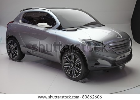 GENEVA - MARCH 8: The futuristic Peugeot HR1 concept with hybrid engine on display at the 81st International Motor Show Palexpo-Geneva on March 8, 2011 in Geneva, Switzerland. - stock photo