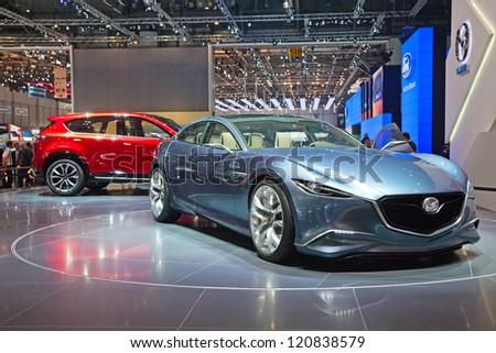 GENEVA - MARCH 8: The Mazda concept preview on the 81st International Motor Show Palexpo-Geneva on March 8; 2011 in Geneva, Switzerland. - stock photo