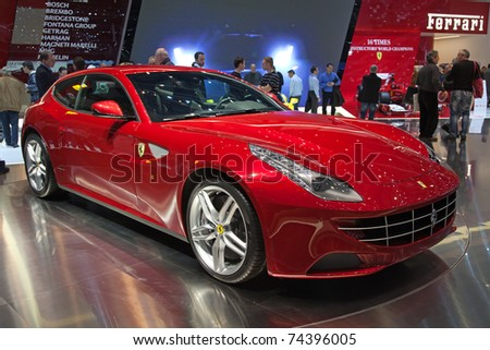 GENEVA - MARCH 8: The new Ferrari FF on display at the 81st International Motor Show Palexpo-Geneva on March 8; 2011  in Geneva, Switzerland. - stock photo