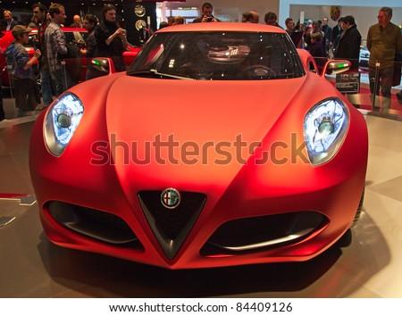 GENEVA - MARCH 8: The new futuristic Alfa Romeo 4C preview on the 81st International Motor Show Palexpo-Geneva on March 8; 2011  in Geneva, Switzerland. - stock photo