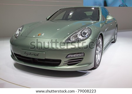 GENEVA - MARCH 8: The Porsche Panomera Hybrid Car preview on the 81st International Motor Show Palexpo-Geneva on March 8; 2011  in Geneva, Switzerland.