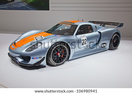 GENEVA - MARCH 8: The Porsche 918 RSR on display at the 81st International Motor Show Palexpo-Geneva on March 8; 2011 in Geneva, Switzerland. - stock photo