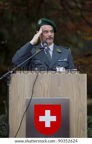 GENEVA - NOV. 13: Unidentified soldier salute at the memorial service to Geneva soldiers on Nov. 13, 2011 in Geneva Switzerland, attended by veterans and serving soldiers - stock photo