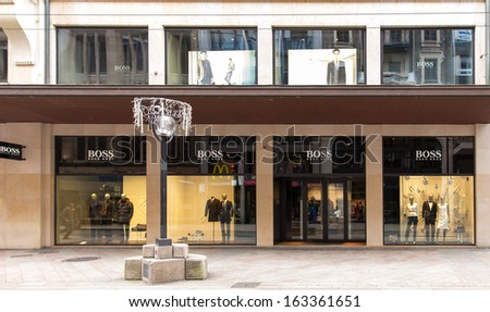 GENEVA, NOVEMBER 17: A HUGO BOSS outlet, November 17, 2013, Geneva, Switzerland. Based in Metzingen in Germany, it has 12,000 staff, 840 own stores and 2012 sales of EUR 2.3 billion in 129 countries.