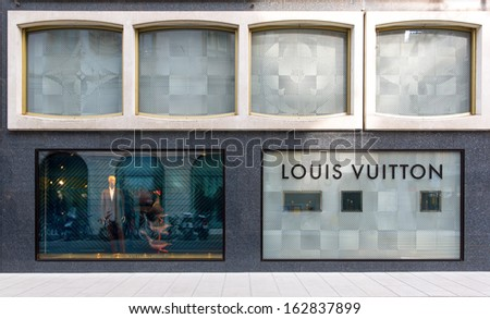 GENEVA - NOVEMBER 13: An Louis Vuitton outlet on November 13, 2013, Geneva, Switzerland. Louis Vuitton, the world's most valuable luxury brand for 2006-2012, was valued in 2012 at US$25.9 billion. - stock photo