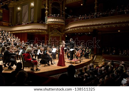 GENEVA - NOVEMBER 17: Conductor Antoine Marguier conducts the United Nations Orchestra and Soprano Alexandra Hewson at the Victoria Hall November 17, 2012 in Geneva, Switzerland. - stock photo