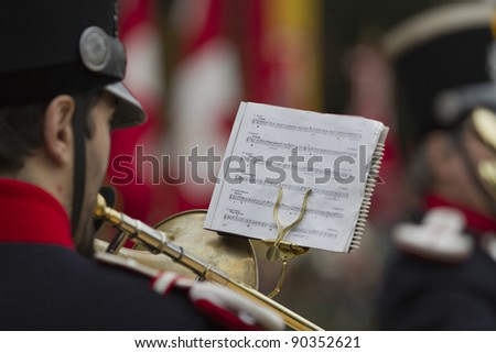 GENEVA - NOVEMBER 13: Trumpeter plays at the memorial service to Geneva soldiers on November 13, 2011 in Geneva Switzerland, attended by veterans and serving soldiers - stock photo