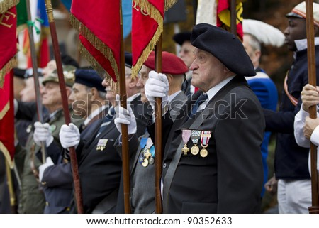 GENEVA - NOVEMBER 13: Veterans stand to attention at the memorial service to Geneva soldiers on November 13, 2011 in Geneva Switzerland, attended by veterans and serving soldiers - stock photo
