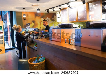 GENEVA - SEP 11: Starbucks cafe interior at train station on September 11, 2014 in Geneva, Switzerland. Starbucks is the largest coffeehouse company in the world, with more then 23000 stores - stock photo