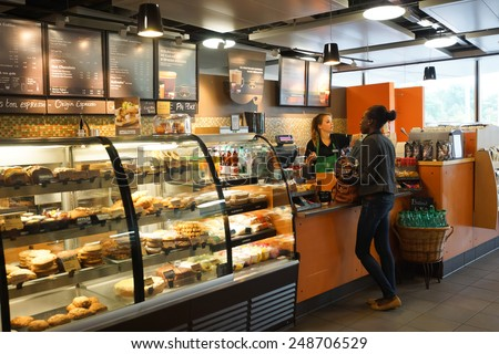 GENEVA - SEP 11: Starbucks cafe interior on September 11, 2014 in Geneva, Switzerland. Starbucks is the largest coffeehouse company in the world, with more then 23000 stores - stock photo
