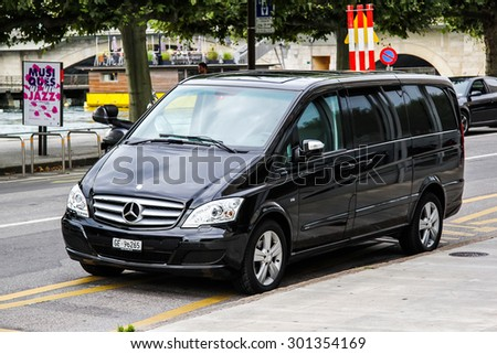 GENEVA, SWITZERLAND - AUGUST 4, 2014: Black luxury van Mercedes-Benz W639 Vito at the city street. - stock photo